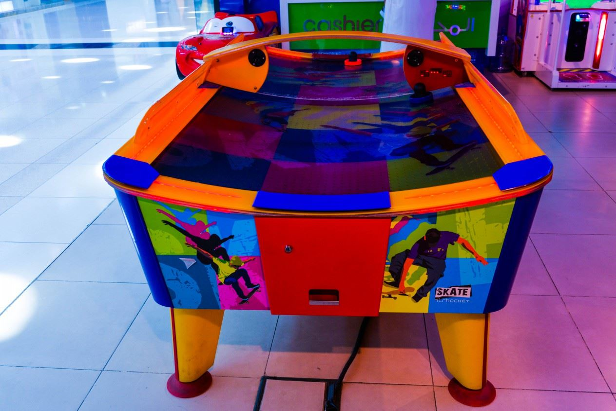 Skate Air Hockey game at Magic Planet Matajer Al Juraina